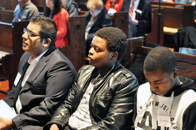 The newly confirmed Hassan Takura-Patrick and Evans listen as watch as Fiachra is received